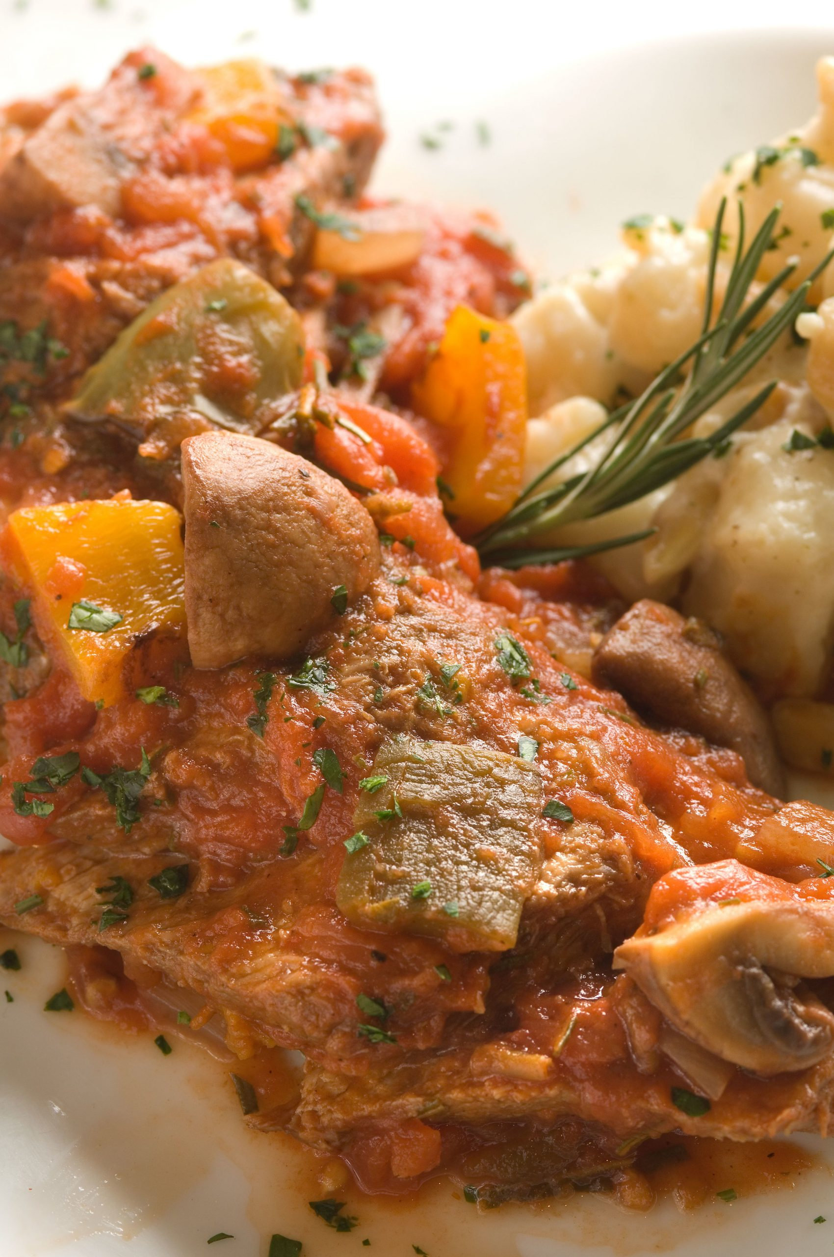 Braised Veal Cacciatore with Spicy Almond and Goat Cheese