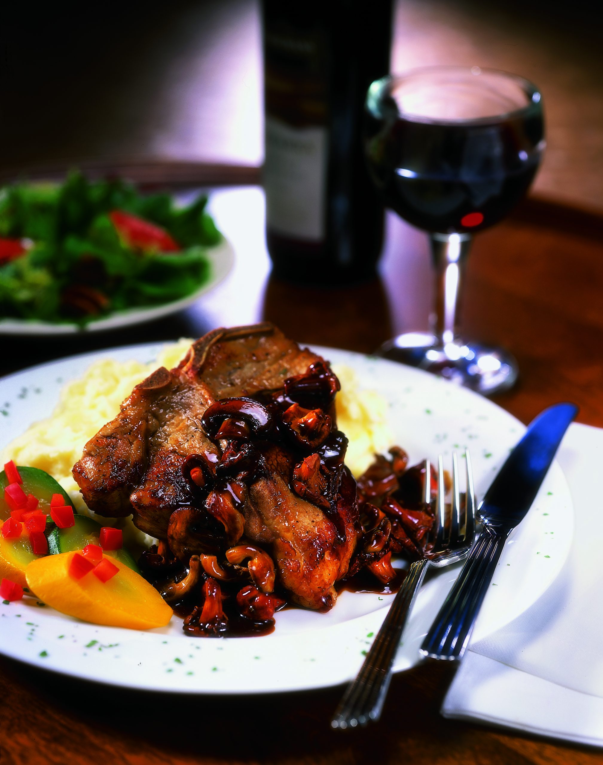 Cajun Veal Chop Smothered in Wild Mushroom Barbeque Demi-Glaze