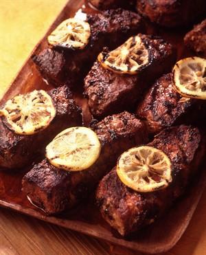 Grilled Veal Tenderloin Steaks with Black Olives