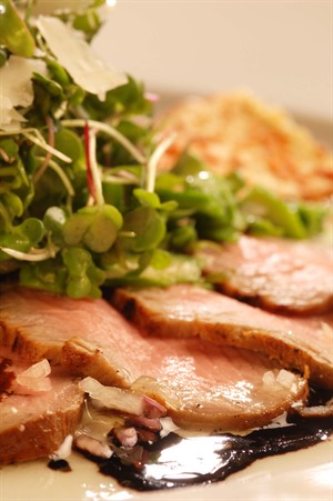 Grilled Marinated Veal Tenderloin with Micro Greens and Sartori Asiago Cheese