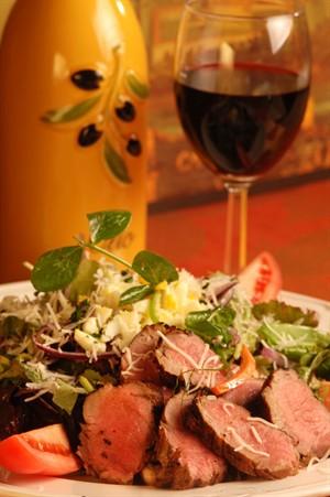 Tabasco Chipotle Veal Tenderloin Salad with Sartori Asiago Cheese